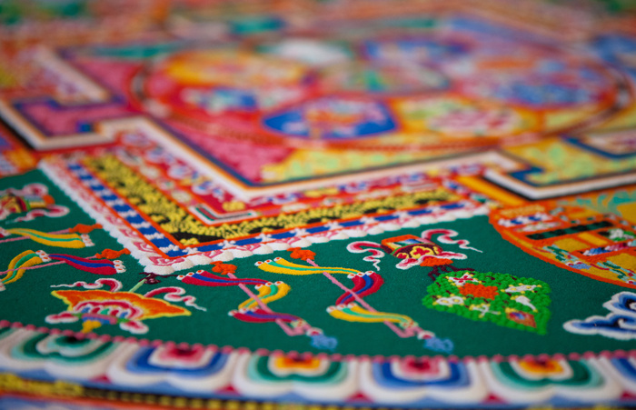 A close up of a completed Green Tara mandala, created by monks from Draping Loseling at Agnes Scott College in Atlanta, Georgia, in 2009. Image: © Zlatko Unger