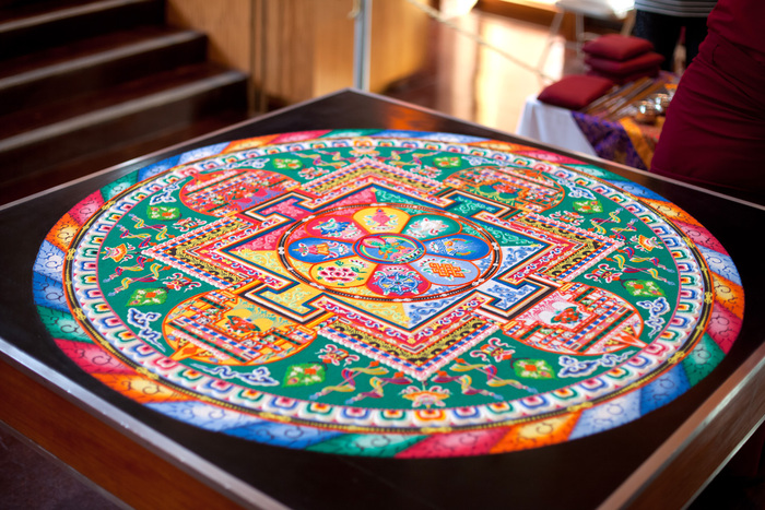 A full view of a completed Green Tara mandala, created by monks from Drepung Loseling at Agnes Scott College in Atlanta, Georgia, in 2009. Image: © Zlatko Unger